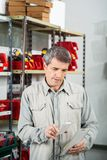Man Scanning Product In Hardware Store Royalty Free Stock Images