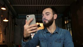 Man scans the face with the phone. Face ID