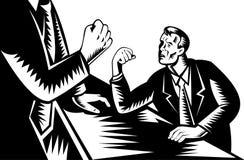Man scared  arm wrestles giant Stock Image