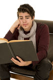 Man with scarf hand on face reading Stock Photos