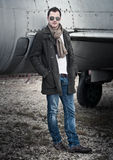 Man with Scarf standing by a Plane Stock Photography
