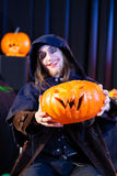 Man in scary Halloween costume with pumpkin Stock Photos
