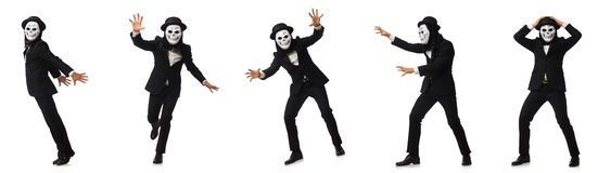 The man with scary mask isolated on white. Man with scary mask isolated on white royalty free stock photography