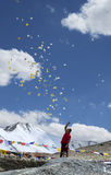 Man scattering buddhist prayer sheets at Tangangla pass on the way to Leh Kalachakra festival Stock Photos