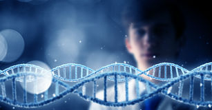 Man science technologist in laboratory. Man scientist looking at DNA molecule image at media screen Royalty Free Stock Image
