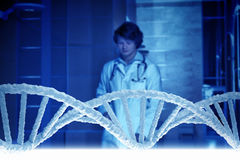 Man science technologist in laboratory. Man scientist looking at DNA molecule image at media screen Stock Photo