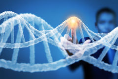 Man science technologist in laboratory. Man scientist touching DNA molecule image at media screen Stock Photo