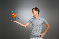 Man scientist with atom model, research concept Royalty Free Stock Photos