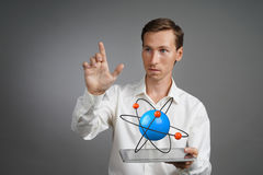Man scientist with atom model, research concept Royalty Free Stock Image