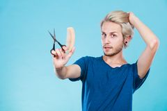 Man with scissors and comb creating new coiffure Royalty Free Stock Image