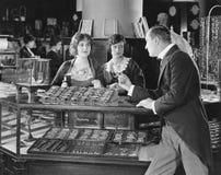 Man scolding saleswomen Stock Photos