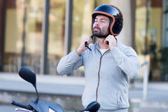 Man on scooter royalty free stock photos