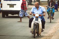 Man on scooter in the street. Sri Lanka. Stock Photos