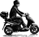 Man on a scooter Stock Images