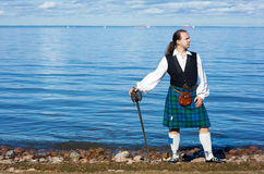 Man in scottish costume with sword Stock Photography