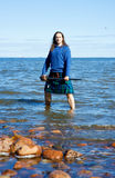 Man in scottish costume in the water