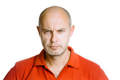 Man scowling. Isolated on white. Studio Stock Image
