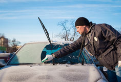 Man scraping front windshield Stock Images
