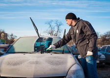 Man scraping front windshield Royalty Free Stock Images