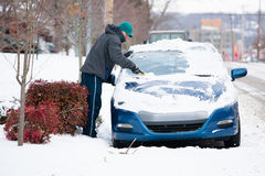 Man Scraping Ice off Car Stock Photo
