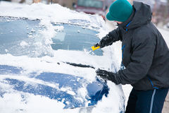 Man Scraping Ice off Car Royalty Free Stock Images