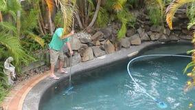 Man Scraping Pool stock footage