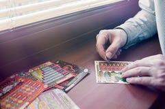 Man scratches Polish lottery scratchcard. stock photos