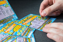 Man scratches Polish lottery scratchcard. royalty free stock photo