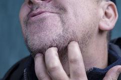 Man Scratching Beard Royalty Free Stock Photography