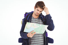 Man scratching head looking in map Royalty Free Stock Photography