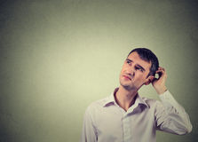 Man scratching head, thinking deeply about something, looking up Royalty Free Stock Images