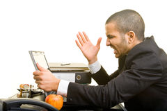 Man screaming. Business man at work screaming at his laptop Royalty Free Stock Photos