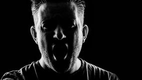 An angry man. A man screaming in anger Royalty Free Stock Image