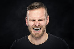 Man screaming angry Stock Images