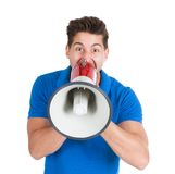 Man screaming into bullhorn while pointing away Stock Image