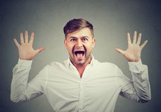 Man screaming at camera in surprise royalty free stock images