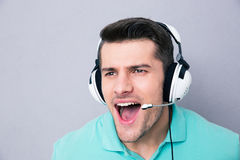 Man screaming in headset Stock Photos