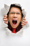 Man screaming from the hole in wall Stock Photos