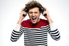 Man screaming while listening to music Stock Photo