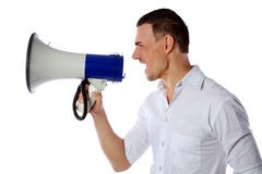 Man screaming in megaphone Royalty Free Stock Images