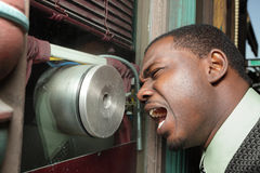 Man screaming at the microphone Stock Photo