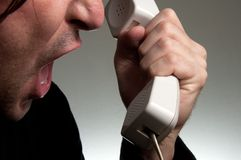 Man screaming on the phone Royalty Free Stock Photo