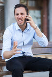 Man screaming on phone Stock Photography