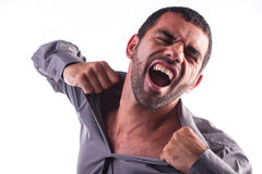 Man screaming and ripping his shirt Royalty Free Stock Image