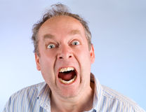Man Screaming about Something. A middle-aged man is screaming for help about something Stock Photo