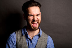 Man screaming in studio Stock Image