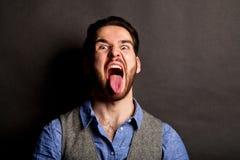 Man screaming in studio Stock Photography