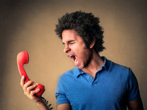 Man screaming on the telephone Stock Photo
