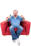 Man screaming at the television Royalty Free Stock Photo