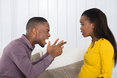 Man Screaming At Woman. Angry Young African Man Screaming At Woman stock images